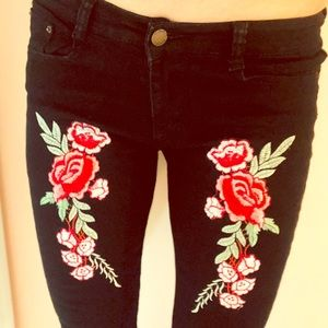 Denim - NWT Black jeans with roses and slits at knee